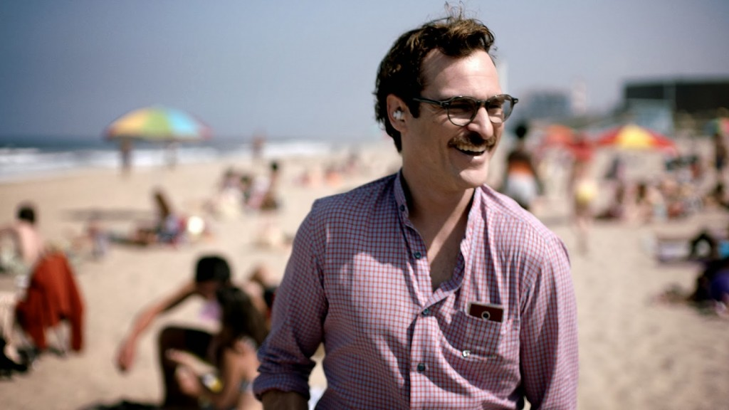 Joaquin Phoenix's character Theodore watching on a beach in a still from the film Her