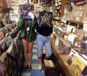 Employees at Play It Again Records hold up releases by Big Star and Mac DeMarco available on Record Store Day.