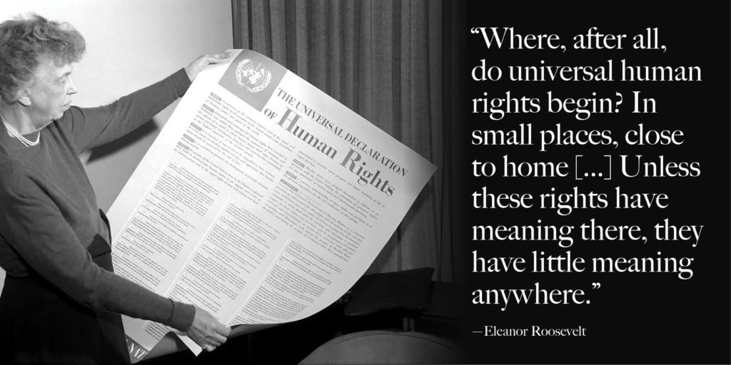 Eleanor Roosevelt holding a Universal Declaration of Human Rights poster