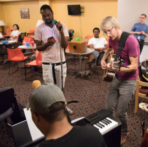 """Dillingham (right) works with teens at Daybreak to write """"Umoja"""""""