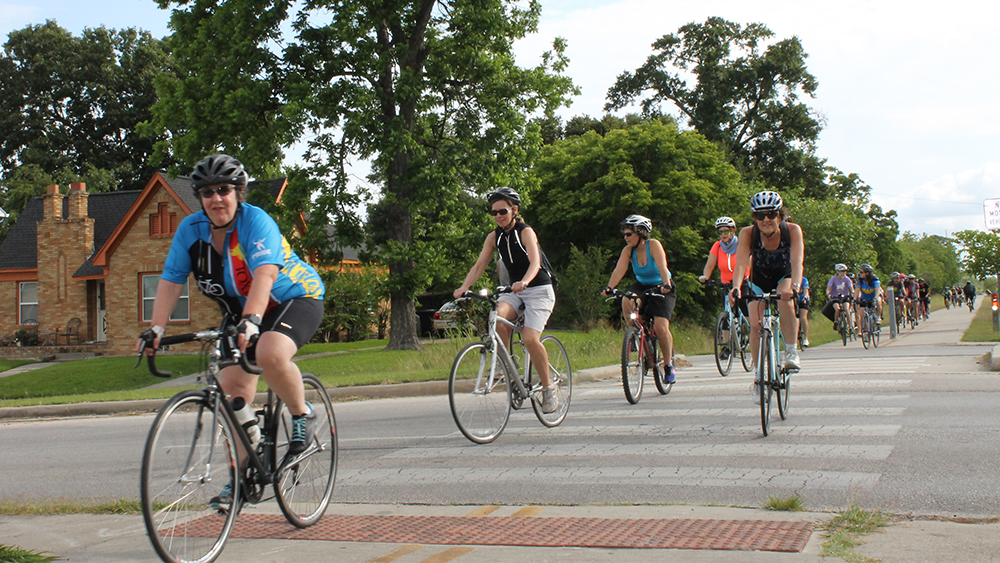 Cyclists ride through Houston on Mother's Day for CycloFemme, one of the city's Bike Month events