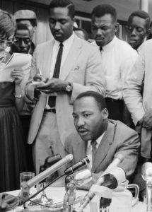 Clarence B. Jones—advisor, personal counsel, speech writer and friend to Dr. Martin Luther King Jr.—takes notes behind King at a press conference regarding Birmingham, Ala., in February 1963.