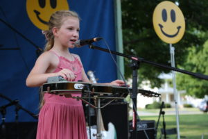 Chloe Finch, then 7 years old, opens for The Kris Lager Band at Levitt AMP Galva in 2018