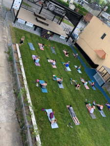 Middlesboro residents partake in socially-distanced yoga on the lawn of Performance Park