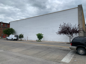 Later this summer, artists from across the country will transform this wall into a mural celebrating Middlesboro's unique history