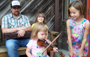 Students learn fiddle fundamentals at the Cowan Creek Mountain Music School