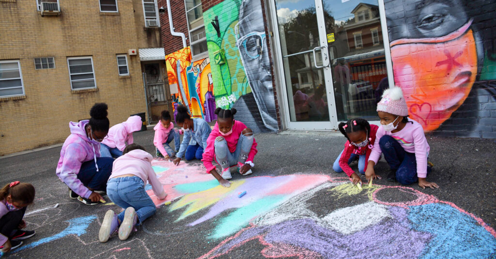 Students from Sprout U School for Performing Arts worked with artist Antoinette Marchfelder during Trenton's Sidewalk Chalk Project