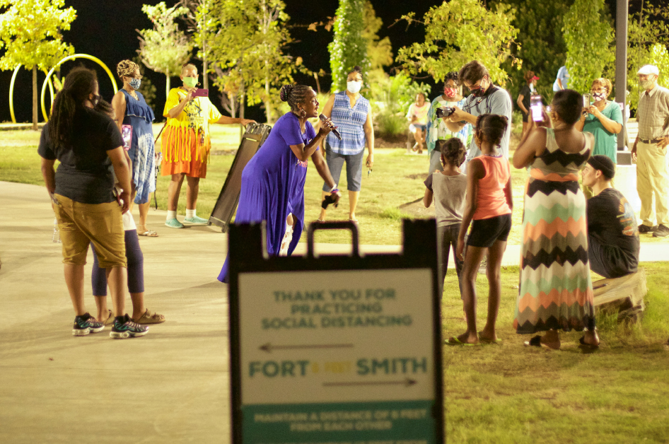 Genine LaTrice Perez performs at a pop-up concert in Fort Smith, Arkansas