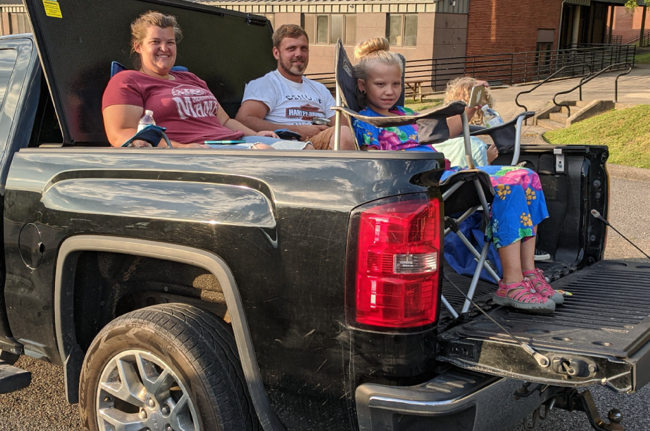 A family enjoys the music at a drive-in concert in Whitesburg, Kentucky