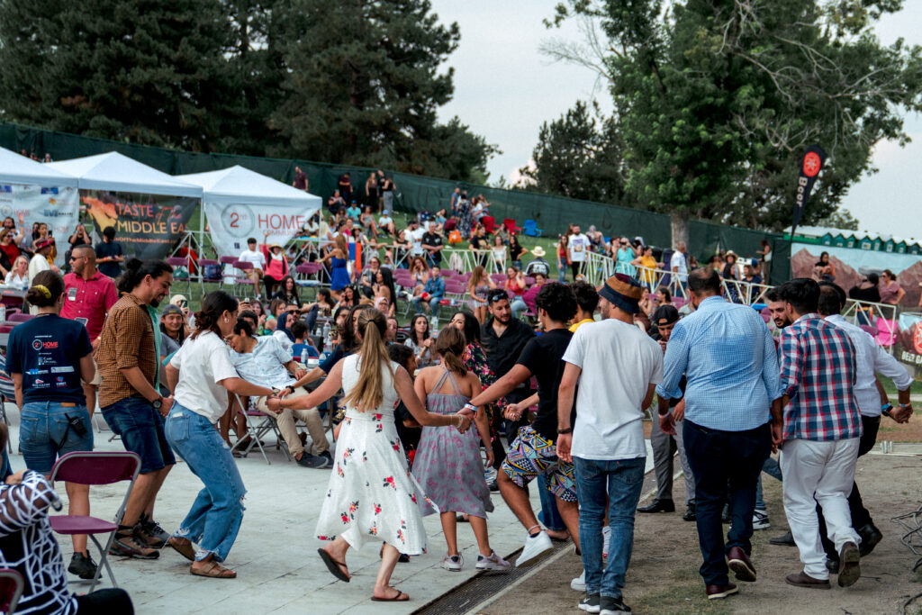 Audience members doing the Dabke traditional dance at the 2021 Taste of The Middle East Festival